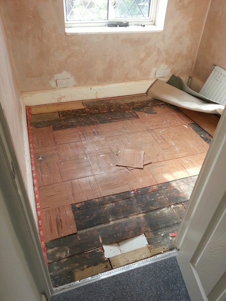 Next up, we had the walls replastered and more electric sockets put in (the house dates from 1934, most rooms only have one socket). We then pulled back the carpet to reveal these lovely vinyl tiles on the floorboards!
