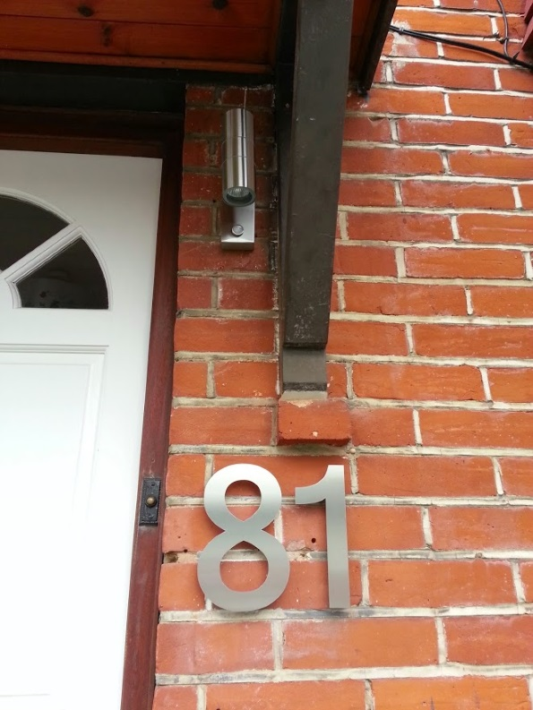 New front door light and number