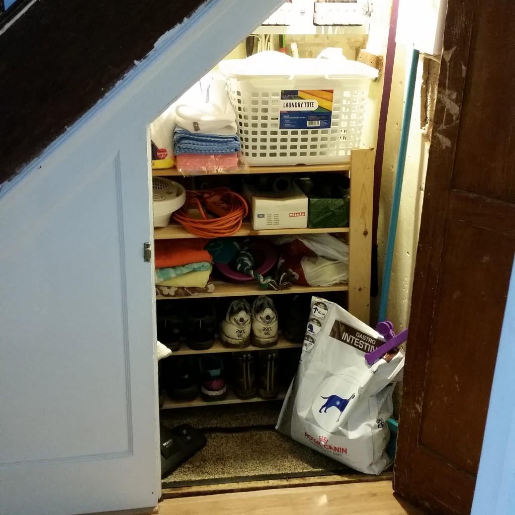 tidy understairs cupboard